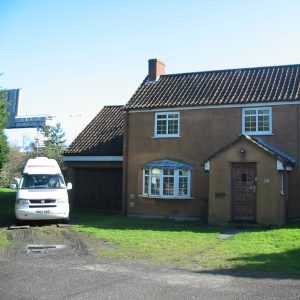 Brown House And White Van